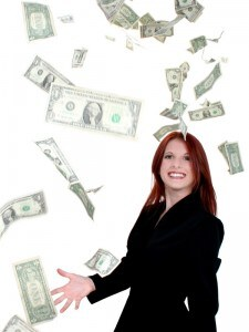 beautiful young business woman throwing money into
