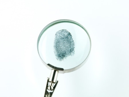 criminal background check magnifying glass fingerprint