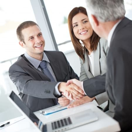 real esate deal shaking hand bank meeting