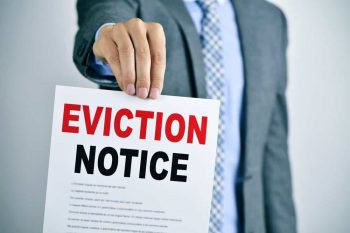 Eviction Notice. Man holding eviction notice